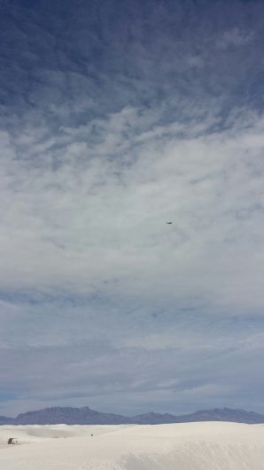 Zoom in, there's an airplane up there