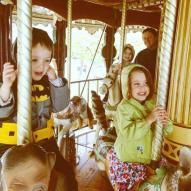 Carousel fun. Maren's on a cat. Weird.