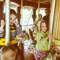 Carousel fun. Maren's on a cat. Weird.